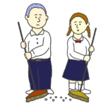 掃き掃除をする学生(男女)