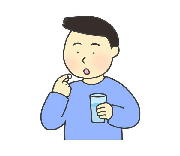 錠剤を飲む男性のイラスト