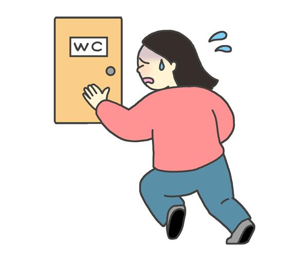トイレに駆け込む女性のイラスト
